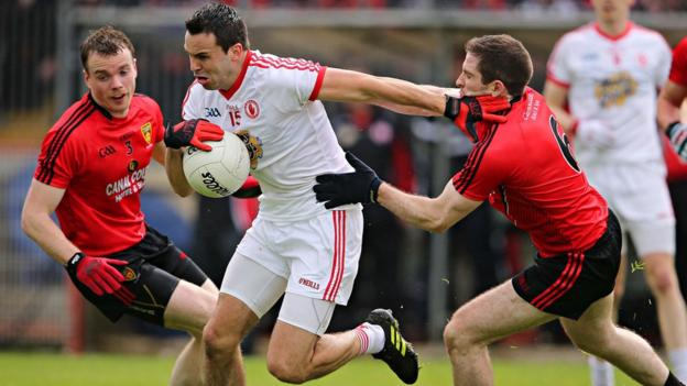 Tyrone forward Kyle Coney, who scored three points, shrugs off the challenge of Mourne defender Aidan Carr