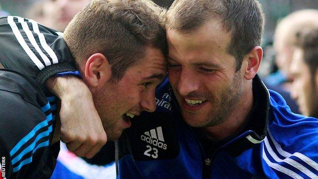 Hamburg skipper Rafael van der Vaart and goalscorer Pierre-Michel Lasogga celebrate the play-off win against Gruether Fuerth