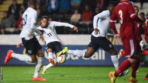 Nathan Redmond of England scores