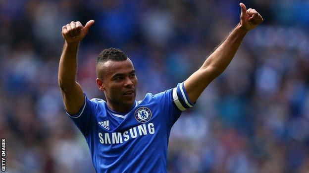 Ashley Cole gives a thumbs up to fans