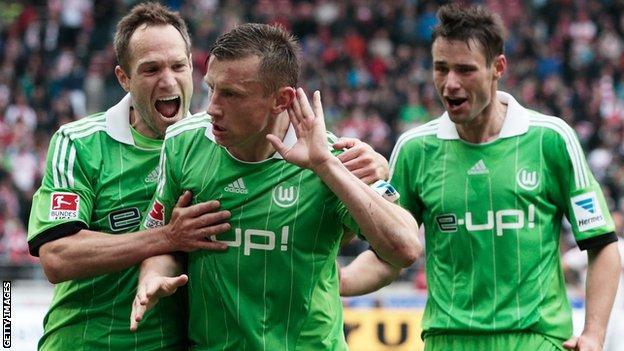 Olic celebrates a goal