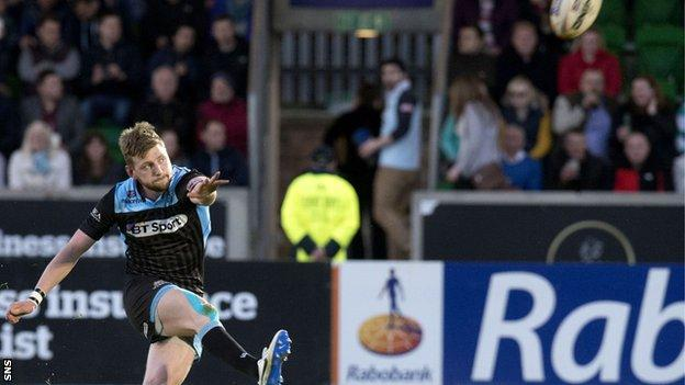 Finn Russell in action for Glasgow