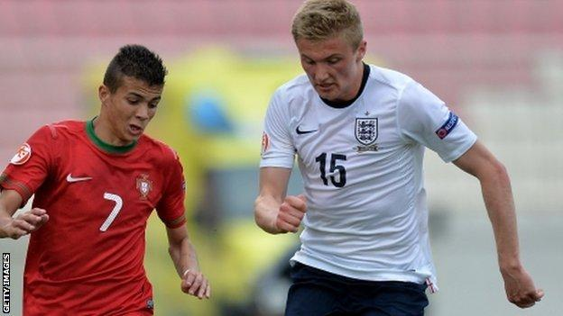 Taylor Moore in action for England (right)