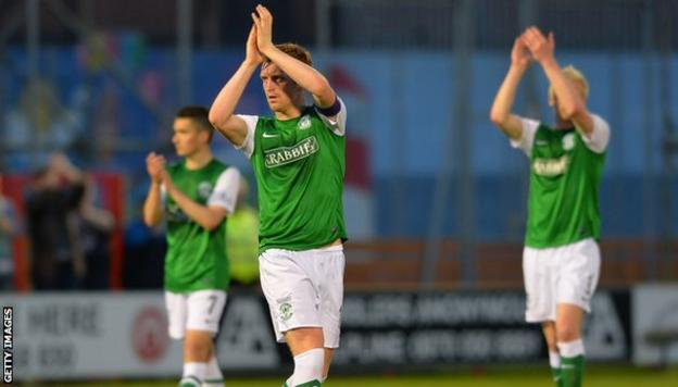 Hibs captain Liam Craig (centre) and team-mates applaud the visiting fans