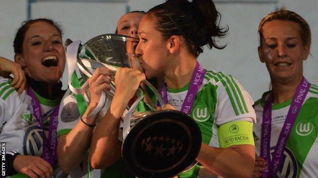 Captain Nadine Kessler kisses the Champions League trophy