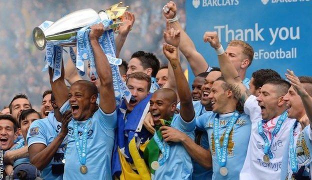 Manchester City lifting the Premier League trophy