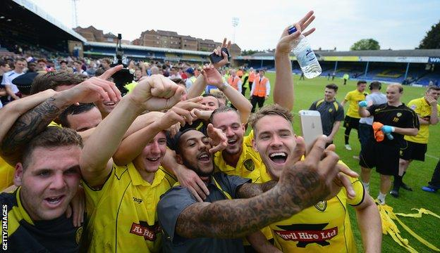 Burton Albion's players celebrate reaching Wembley with a 'selfie'