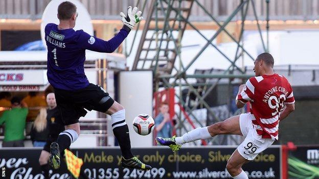 Hibernian goalkeeper Ben Williams saves a shot by Hamilton's Mikael Antoine-Curier