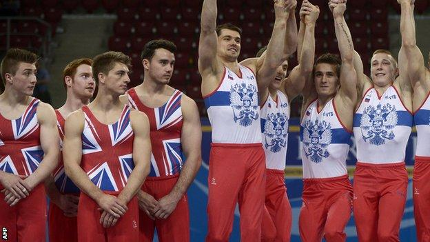 British male gymnasts (l) with winners Russia (r)