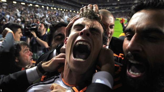Gareth Bale is mobbed by team-mates and fans after putting Real in front against Atletico in the Champions League final