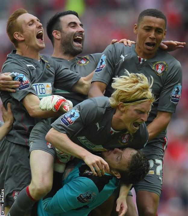 Former Wales defender Craig Morgan celebrates with team-mates after Rotherham beat Leyton Orient on penalties in the League One play-off final at Wembley.