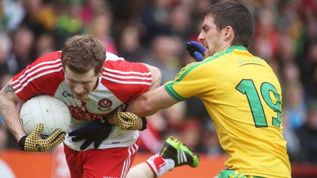 Enda Lynn of Derry is challenged by Donegal opponent Paddy McGrath during the Ulster Championship clash at Celtic Park