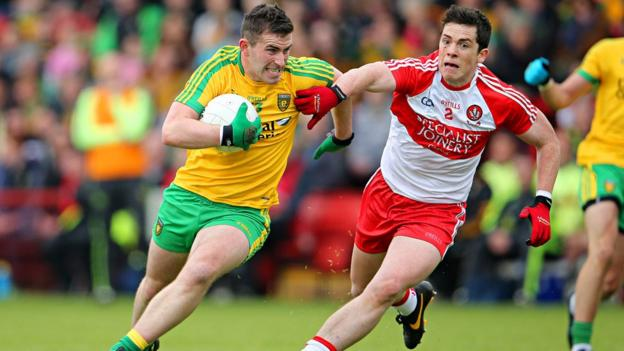 Donegal forward Patrick McBrearty tries to get away from Derry opponent Ryan McBride during the Championship game at Celtic Park