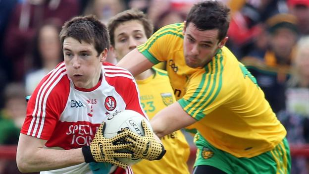 Derry's Gareth McKinless in possession against Donegal's Odhran MacNiallais at Celtic Park