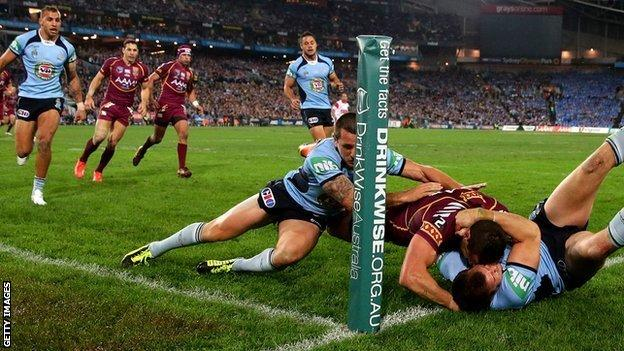 NSW bundle Darius Boyd of Queensland into touch