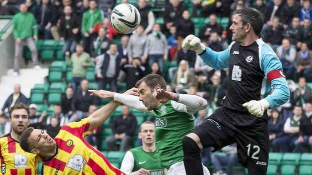 Partick Thistle goalkeeper Paul Gallacher in action against Hibernian
