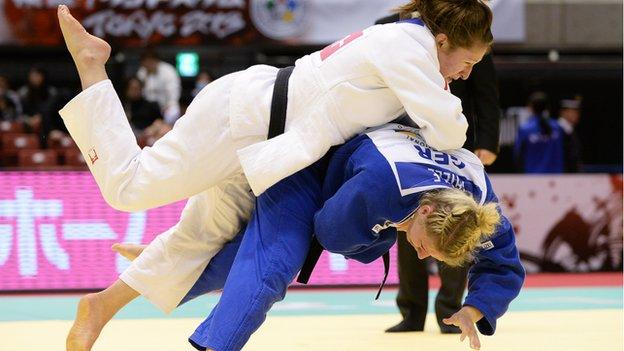 Natalie Powell (white) of Great Britain and Kerstin Thiele of Germany compete clash at the the 2013 Judo Grand Slam in Tokyo