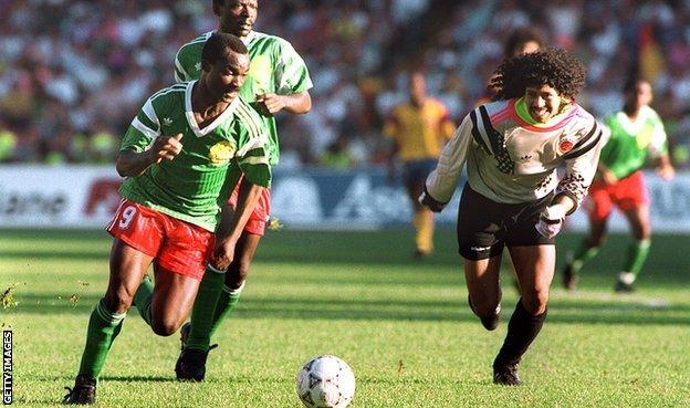 Roger Milla steals the ball from Colombia keeper Rene Higuita at Italia '90