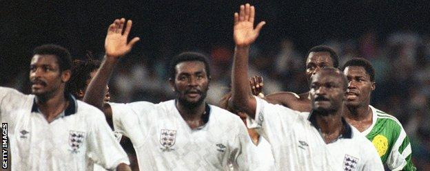 Roger Milla and his Cameroon team-mates wave to the crowd after their defeat by England