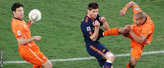 Nigel De Jong escaped with a yellow card for this tackle on Xabi Alonso