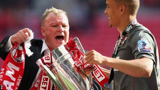 Rotherham United's Manager Steve Evans and James Tavernier celebrate with the trophy after the match