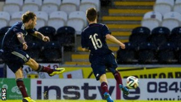Stevie May scores a consolation goal for Scotland against the dominant Dutch