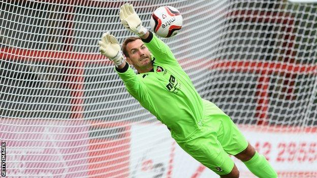 Scott Brown makes a save for Cheltenham