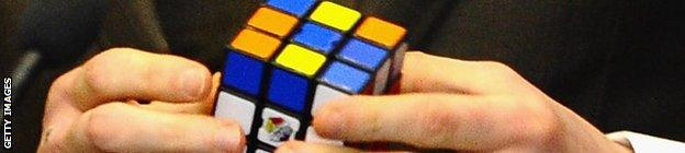 George Groves' mind games include playing with a Rubik's cube in the first press conference for the rematch