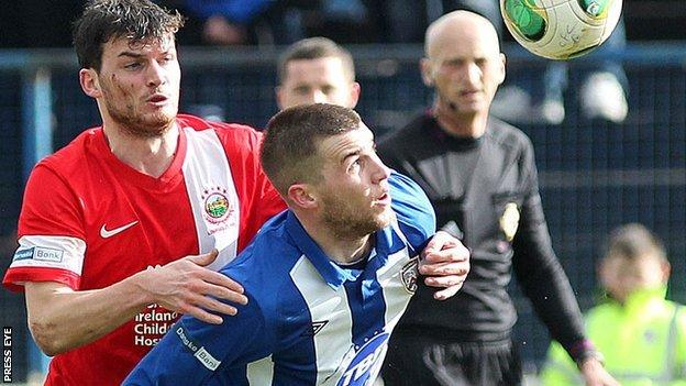 Linfield's Philip Lowry puts pressure on his older brother Stephen
