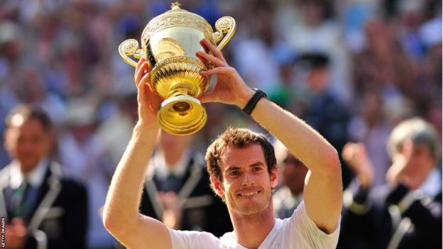 Andy Murray hold the Wimbledon trophy aloft after his historic triumph at SW19