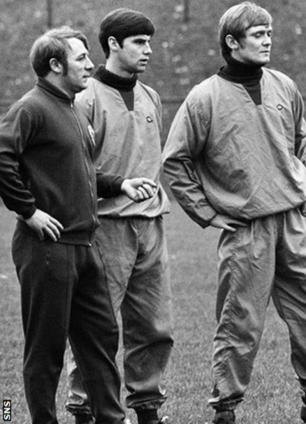 Tommy Docherty instructs Martin Buchan and Davie Hay at a Scotland training session