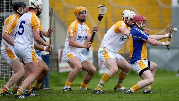Antrim goalkeeper Chris O'Connell saves a Wexford free