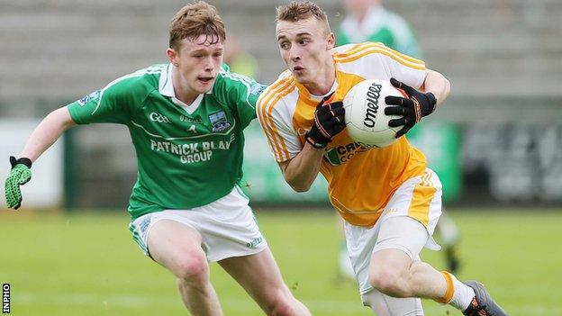 Fermanagh's Enda Cassidy challenges Seamus McGarry