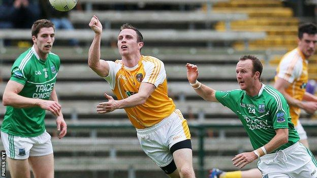 Antrim's Michael McCann in possession against Eoin Donnelly and Paul Ward of Fermanagh