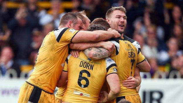 Castleford celebrate another Luke Dorn try