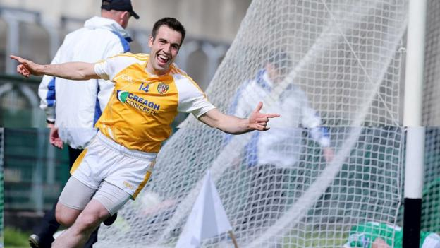 A delighted Kevin Niblock nets for Antrim, who survived a late Fermanagh fightback to win 2-18 to 3-13
