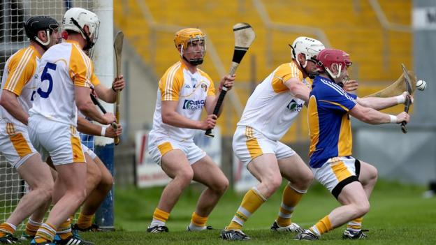 Wexford netted twice in the opening four minutes but Saffrons keeper Chris O'Connell keeps out this free