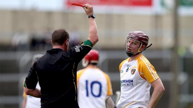 Antrim's Eoin Campbell is shown a red card in the dying seconds as the Ulster side suffer a 5-19 to 0-21 defeat