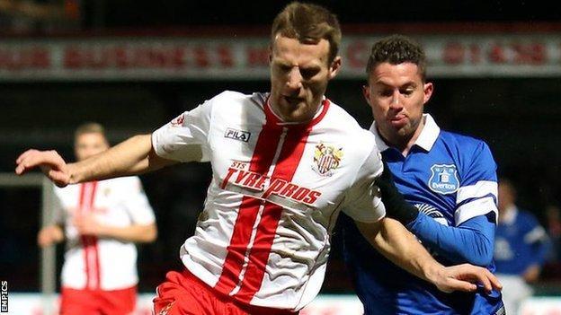 Stevenage's Luke Jones (left) in action against Everton's Bryan Oviedo