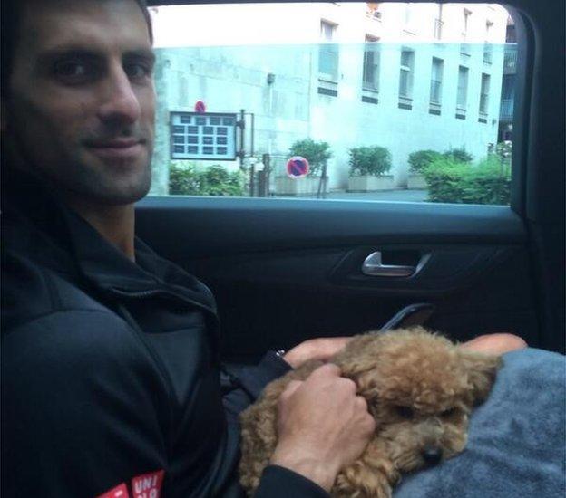 Novak Djokovic and dog