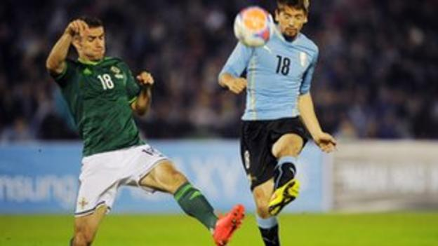 Aaron Hughes in action during the international friendly against Uruguay