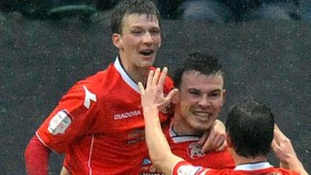 Centre-half partnership Paul Downing and Andy Butler celebrate a goal at Deepdale