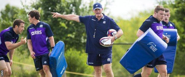 Head coach Vern Cotter puts the Scotland players through their paces in training