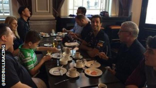 Red Bull driver Daniel Ricciardo enjoys breakfast at the team hotel in Montreal with a few fans.