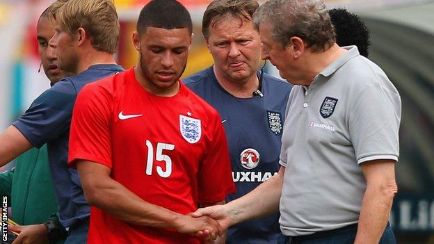 England midfielder Alex Oxlade-Chamberlain and manage Roy Hodgson