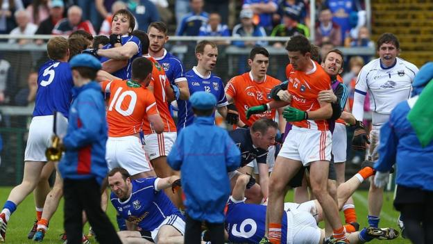 Players from both sides clash before the start of the Ulster SFC quarter-final at the Athletic Grounds