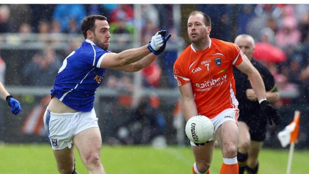 Eugene Keating closes in on Ciaran McKeever as Armagh defeat Cavan in the last eight tie at the Athletic Grounds