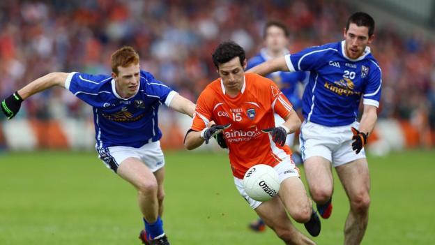 Cavan players Jason McLaughlin and Killian Brady in hot pursuit of Armagh forward Jamie Clarke