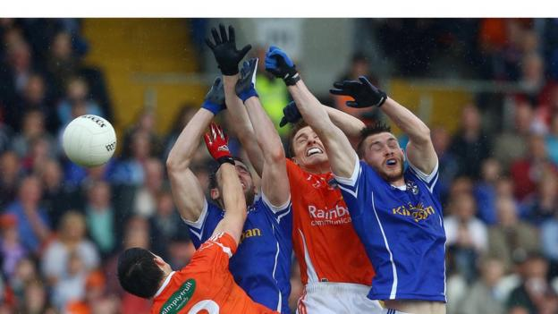 Armagh pair James Morgan and Charlie Vernon challenge for possession with Eugene Keating and David Givney