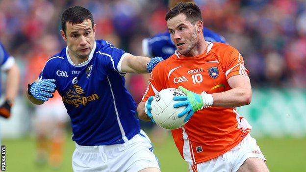 Cavan's Alan Clarke attempts to keep pace with Armagh's Eugene McVerry